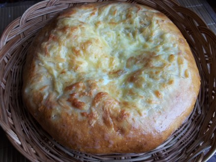 Recipe for Megruli Khachapuri (a circular cheese bread with cheese added on top