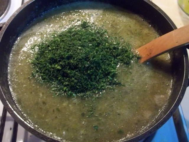 Adding Herb to Tkemali Recipe