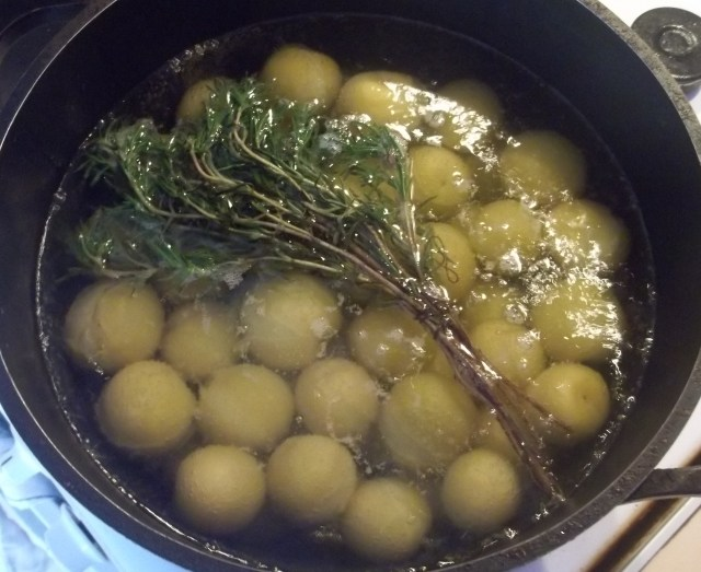 Adding Herbs to boiled Plums for Tkemali Recipe