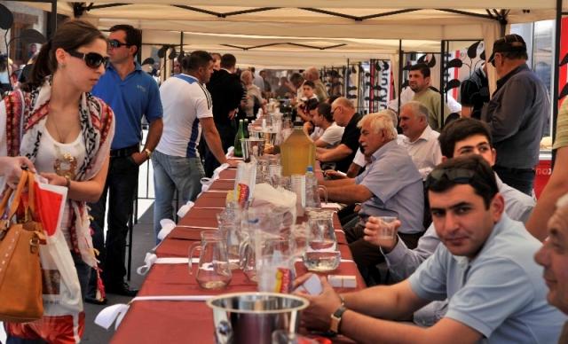 Visitors Sample Wine at the Kartli Wine Festival in Gori