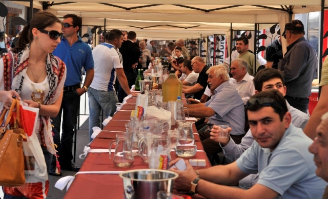 Visitors Sample Wine at the Kartli Wine Festival in Gori