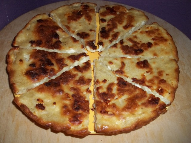 Mokhrakuli Khachapuri Cut for Serving