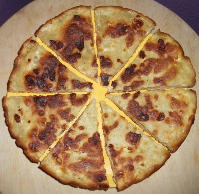 Mokhrakuli Khachapuri Cut into Slices for Serving