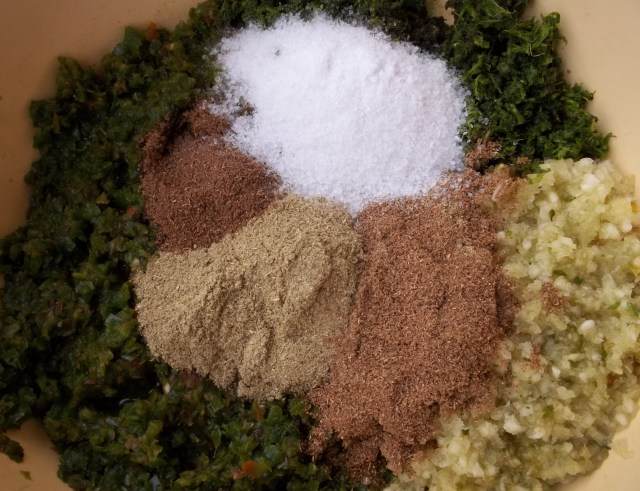Adding Spices and Salt for Green Ajika Recipe