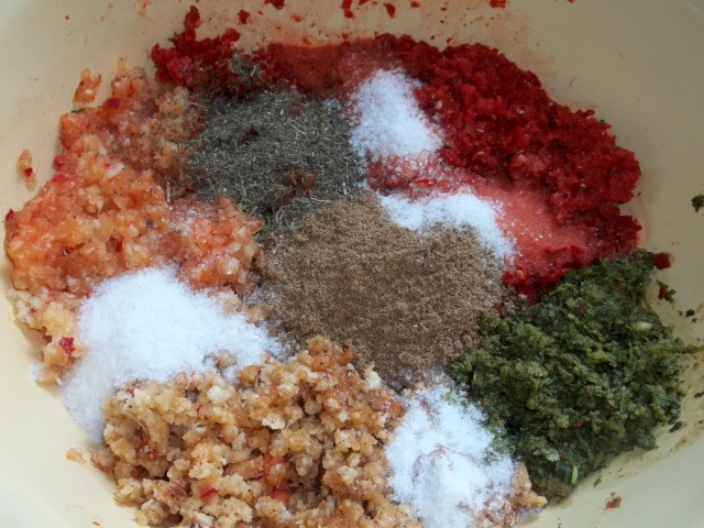 Adding Spices to Crushed Ingredients for Ajika with Walnuts Recipe
