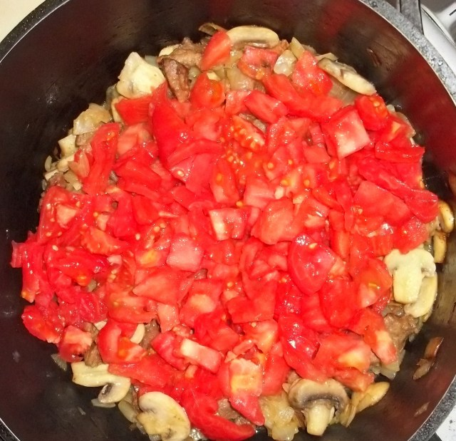 Adding Tomatoes for Pork Chashushuli with Mushrooms