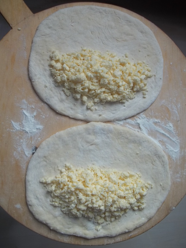 Cheese placed on Khachapuri Dough