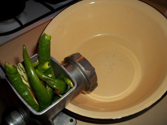 Grinding Green Peppers for Green Ajika Recipe