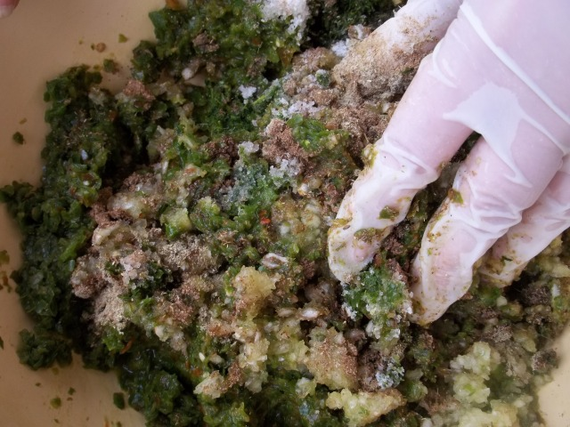 Hand Mixing Ingredients for Green Ajika