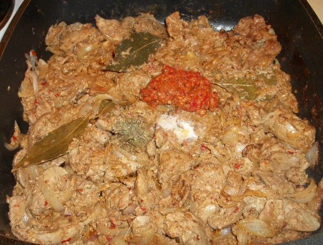 Adding Ajika and Spices to Chicken Liver with Ajika and Summer Savory Recipe