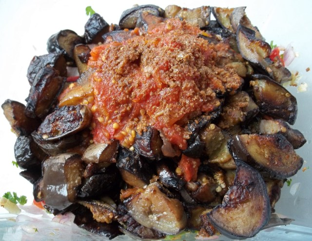 Adding Mixed Ingredients to Eggplant Recipe