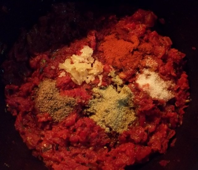 adding-spices-and-garlic-to-fried-beetroot-with-tomatoes-and-spices-recipe