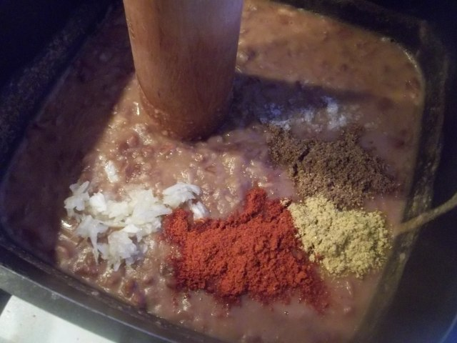 Adding Spices and Garlic to Lobio with Corn Recipe