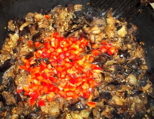 adding-sweet-red-pepper-to-eggplant