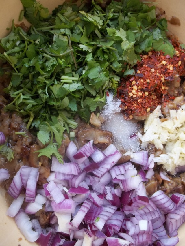 Adding Ingredients to Chopped Fried Eggplant