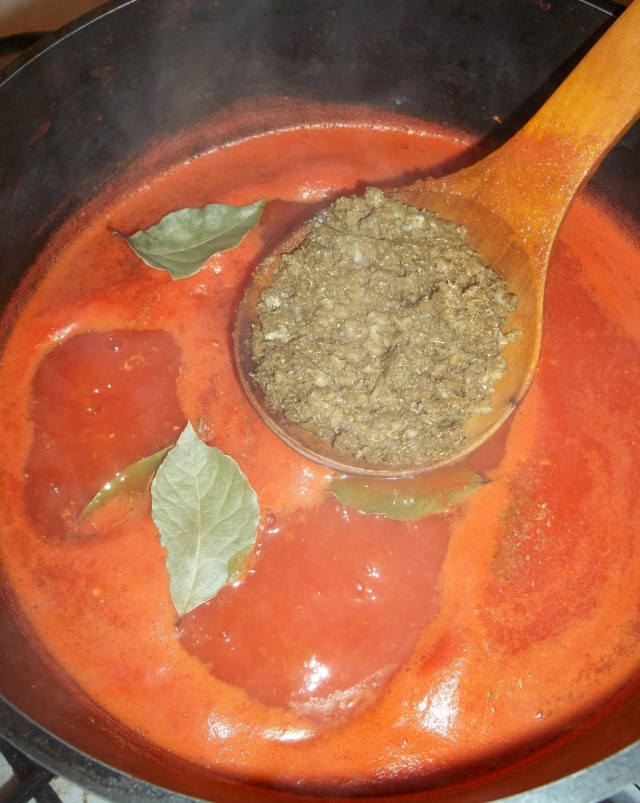 adding-ingredients-to-spicy-tomato-sauce-recipe
