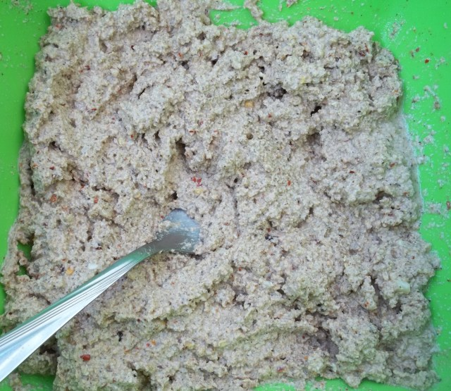 Mixing Spices and Walnuts for Shallot Satsivi Recipe