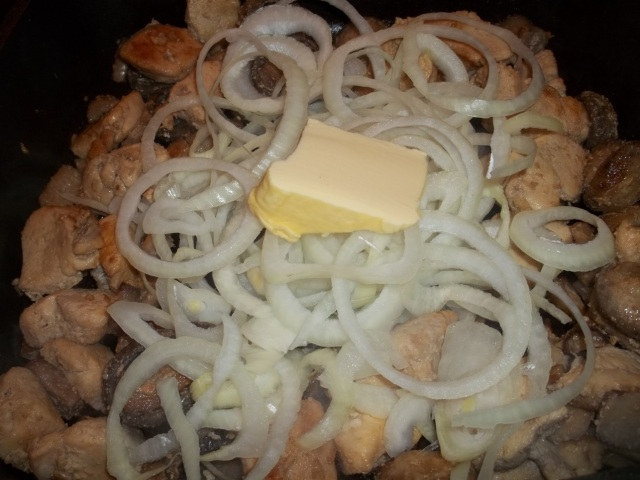 Adding Butter and onions to chicken and mushrooms - Copy