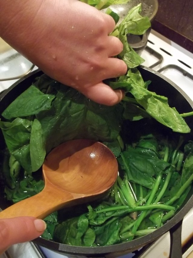 Adding Spinach Leaves to a Pot