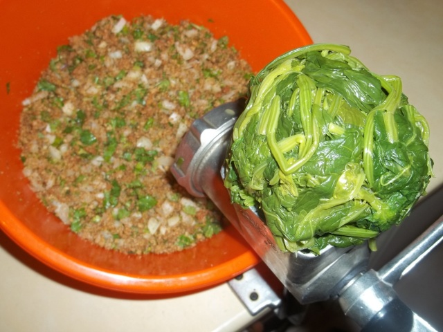 Grinding Boiled Spinach for Spinach Pkhali Recipe