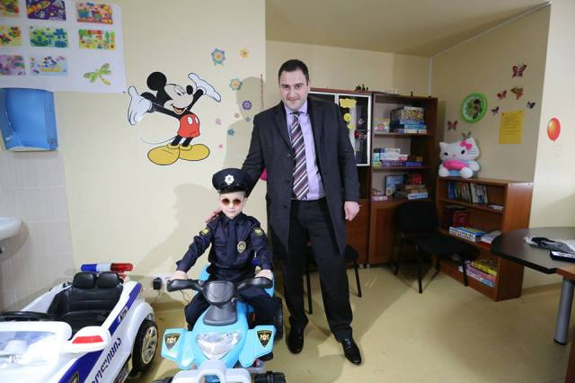 The Interior Minister, Alexander Chikaidze, with one of the boys
