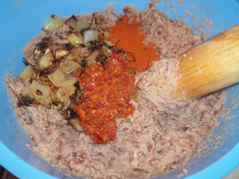 Adding Fried Onions and Ajika and Red Pepper to Lobio - Copy
