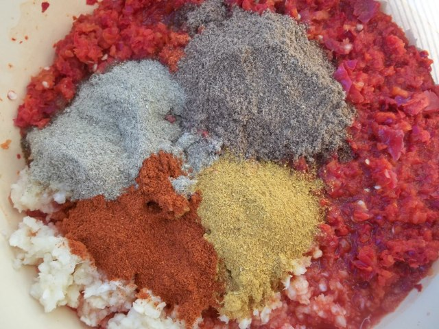 Adding Spices to Ground Peppers and Garlic