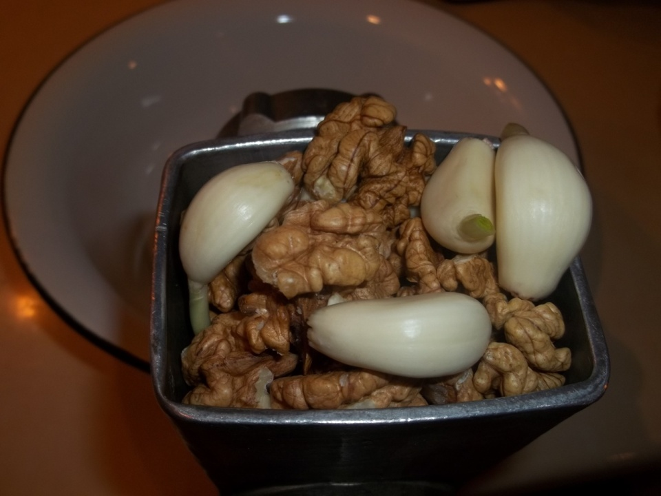 Crushing Walnuts and Garlic