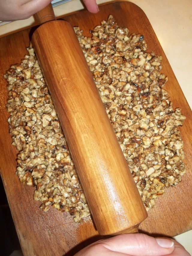 Using a Rolling Pin to Flatten the Gozinaki Mixture - Copy