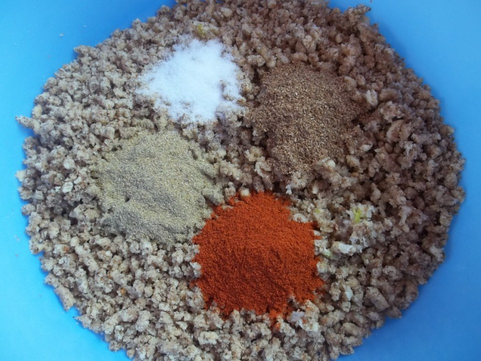 Adding Spices to Walnuts and Garlic - Copy
