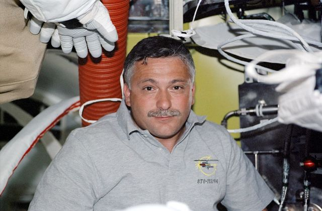 Fyodor Yurchikhin inside the Quest airlock during the STS-112 mission to the International Space Station.