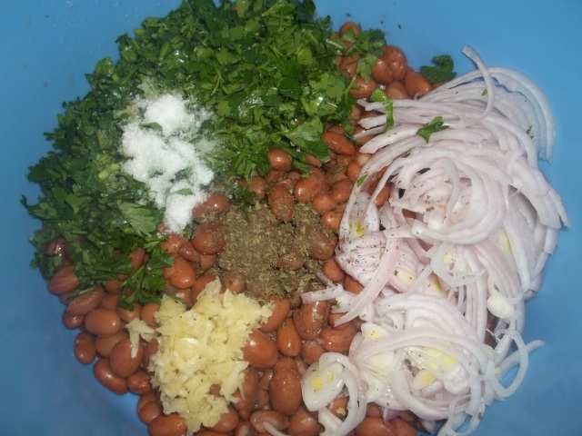 Adding Ingredients to Boiled Lobio Beans - Copy