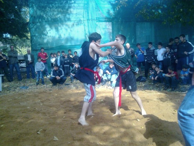 Georgian wrestling competition at the Bidzinaoba Festival