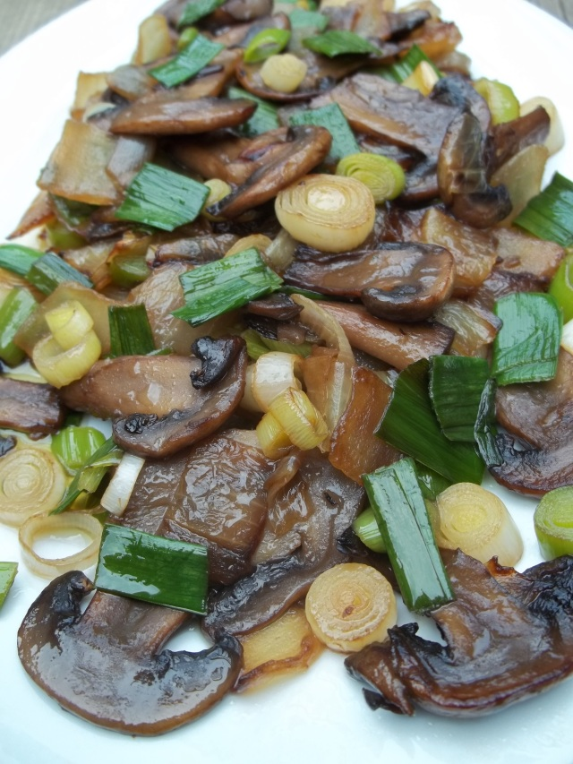 A Serving of Green Garlic with Mushrooms