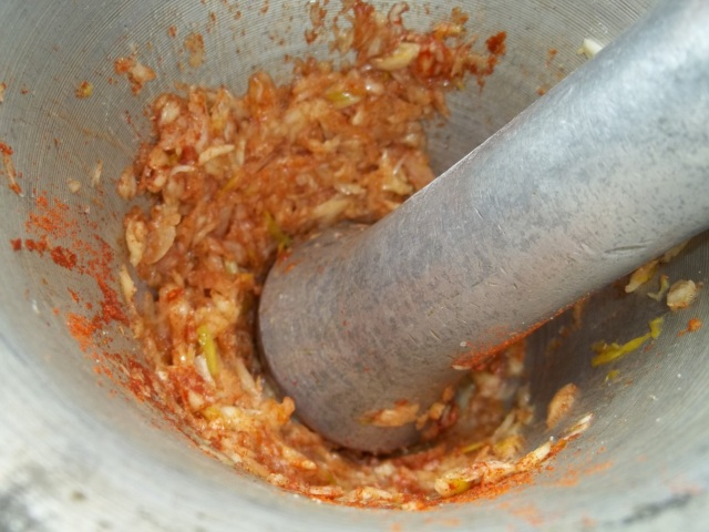 Crushing the Garlic and Pepper - Copy