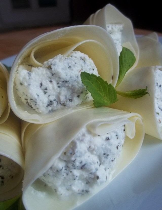 Cottage Cheese with Mint wrapped in sulguni ready for serving - Copy