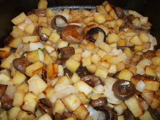 Frying onions potatoes and mushrooms - Copy