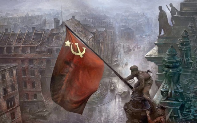 Raising the Soviet flag over the Reichstag in Berlin, 1945