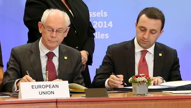 Georgian Prime Minister Irakli Garibashvili and Herman Van Rompuy President of the European Council Herman Van Rompuy signthe Association Agreement.