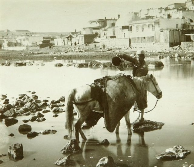 Collecting water from the river in 19th century Tiflis.