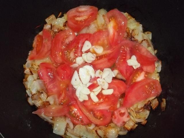 Adding Tomatoes and Garlic