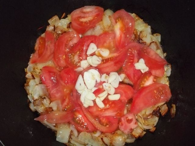 Adding Tomatoes and Garlic