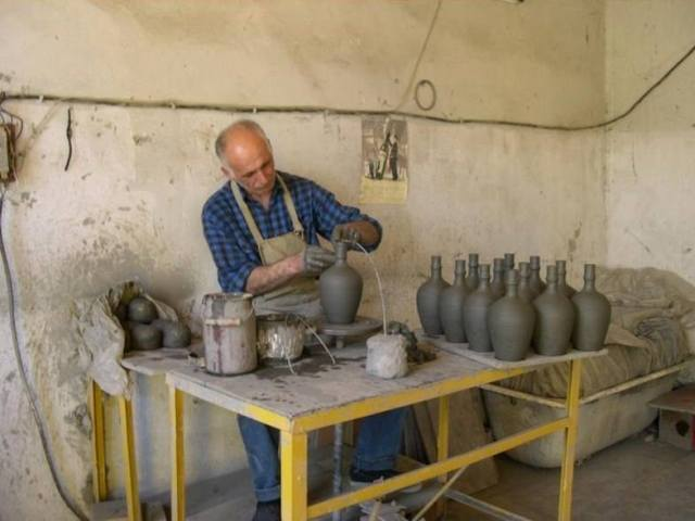 Ceramic wine and chacha bottles are handmade at the Mildiani Family Winery ceramic workshop.