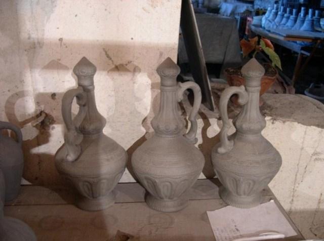 Ceramic wine bottles before glazing and firing.
