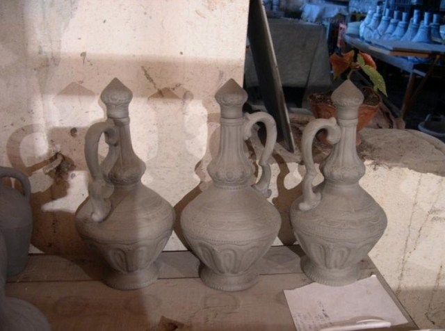 Ceramic wine bottles before glazing and firing.