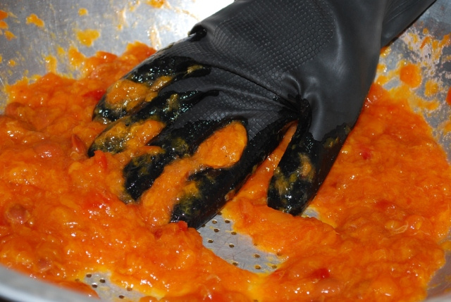 Use a glove to squash the plums - Copy
