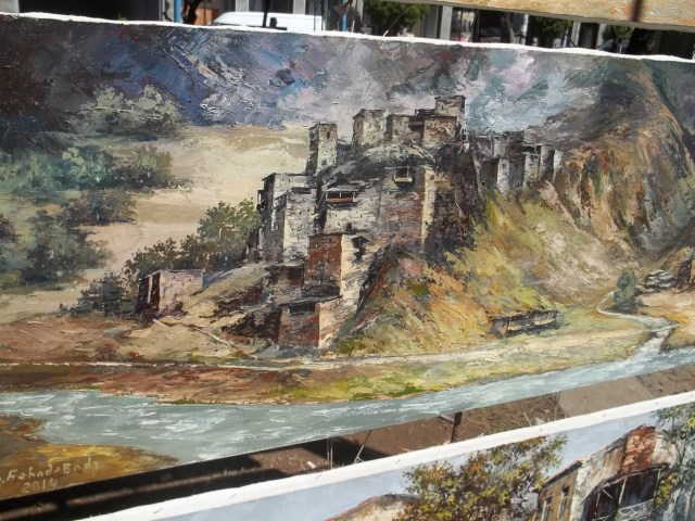 A painting of Shatili at the Dry Bridge Art Market in Tbilisi