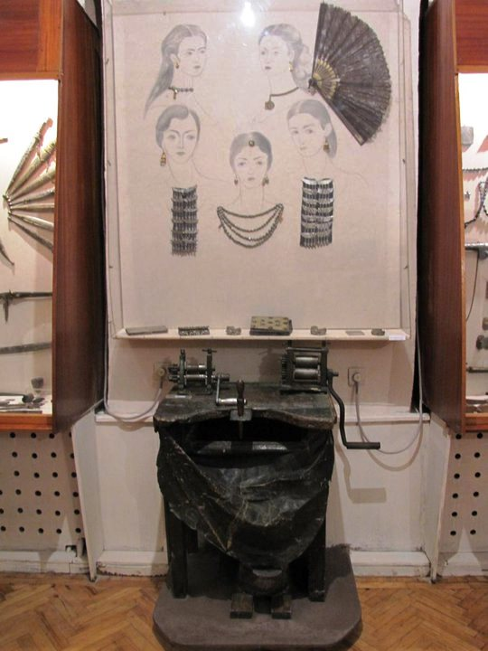 A display of jewelry and goldsmith machinery