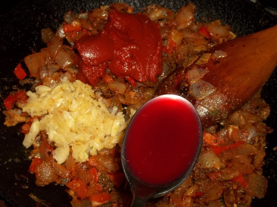 Adding Pomegranate Juice, Garlic and Tomato Puree