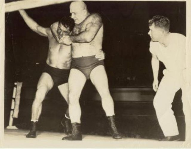 Kola Kwariani wrestling in a match in the U.S.A.